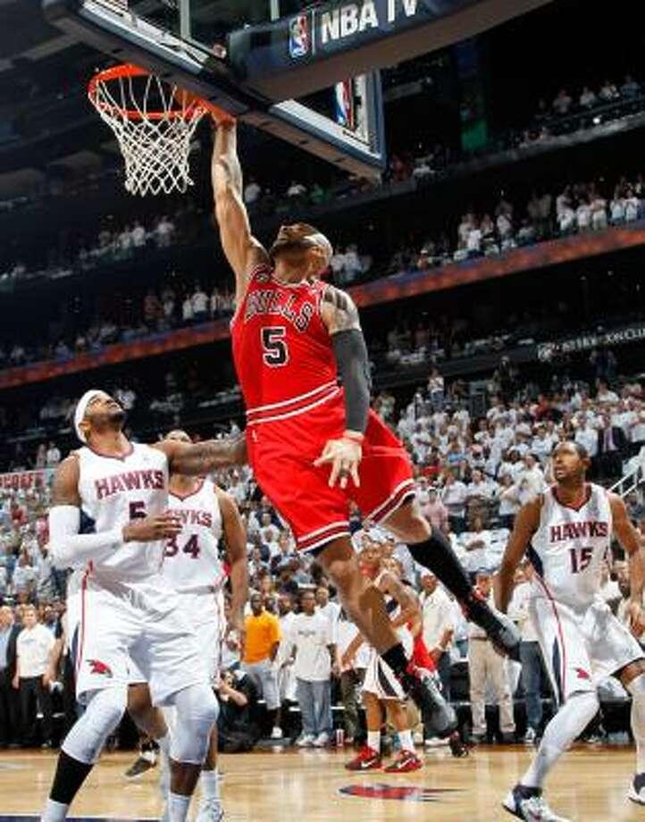 Bulls forward Carlos Boozer dunks over Hawks forward Josh Smith (5). Photo: Kevin C. Cox, Getty Images