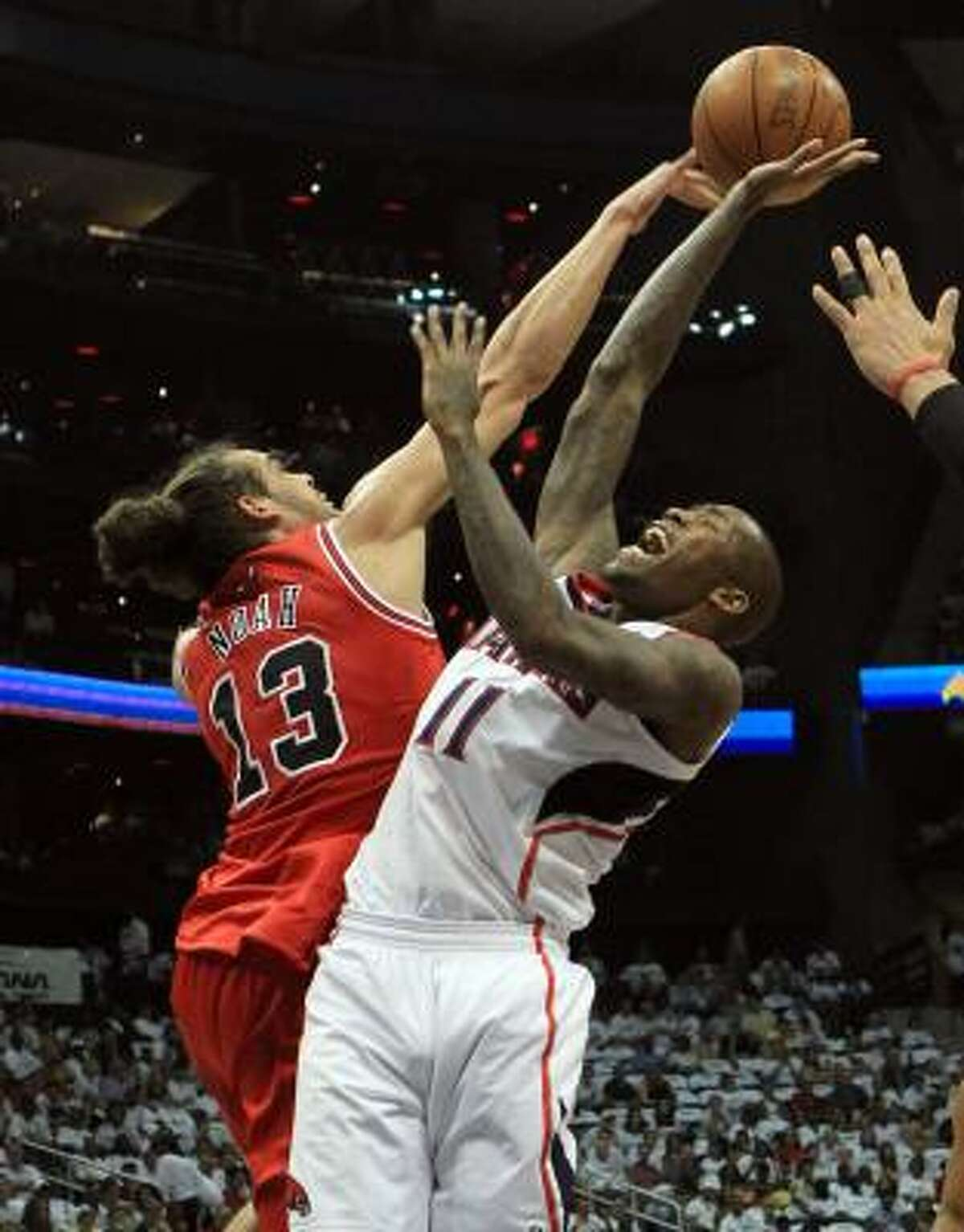 Bulls center Joakim Noah (13) blocks a shot by Hawks guard Jamal Crawford during first-half action.