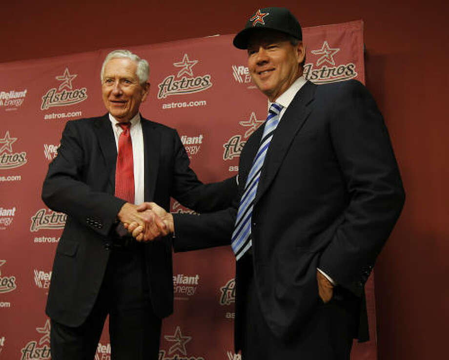 Sold!Astros owner Drayton McLane, left, announced Tuesday that he would be selling his franchise to an group headed by local businessman Jim Crane for $680 million. The acquisition is pending approval by Major League Baseball owners, but Astros fans are surely wondering how the change in ownership will affect the franchise in the long term. Photo: Karen Warren, Chronicle