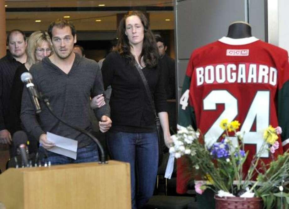 Aaron and Krysten Boogaard  address Minnesota Wild fans during a memorial at Xcel Arena. Photo: Jim Mone, Associated Press