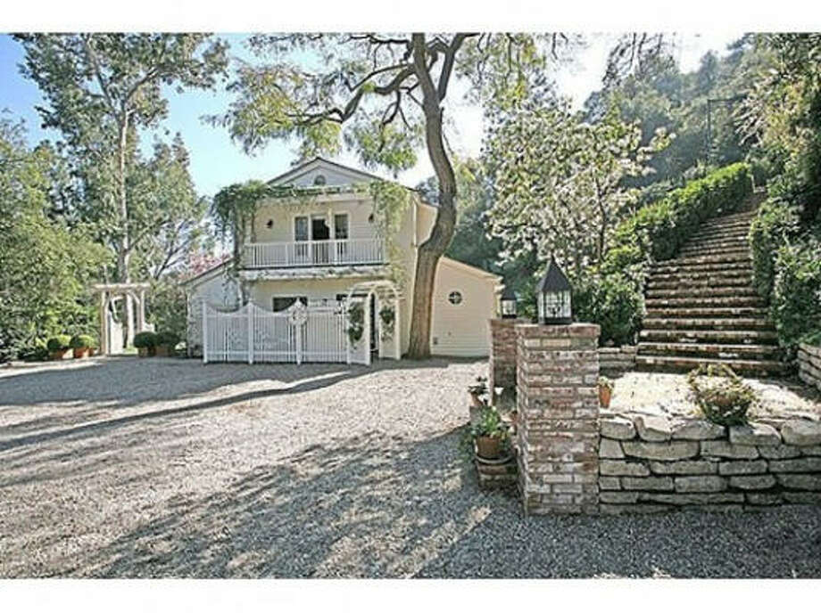 A pea gravel driveway and winding stairway greet you at the entrance of the home. The home is located on a secluded 1.5 acres. Photo: Prudential California Realty