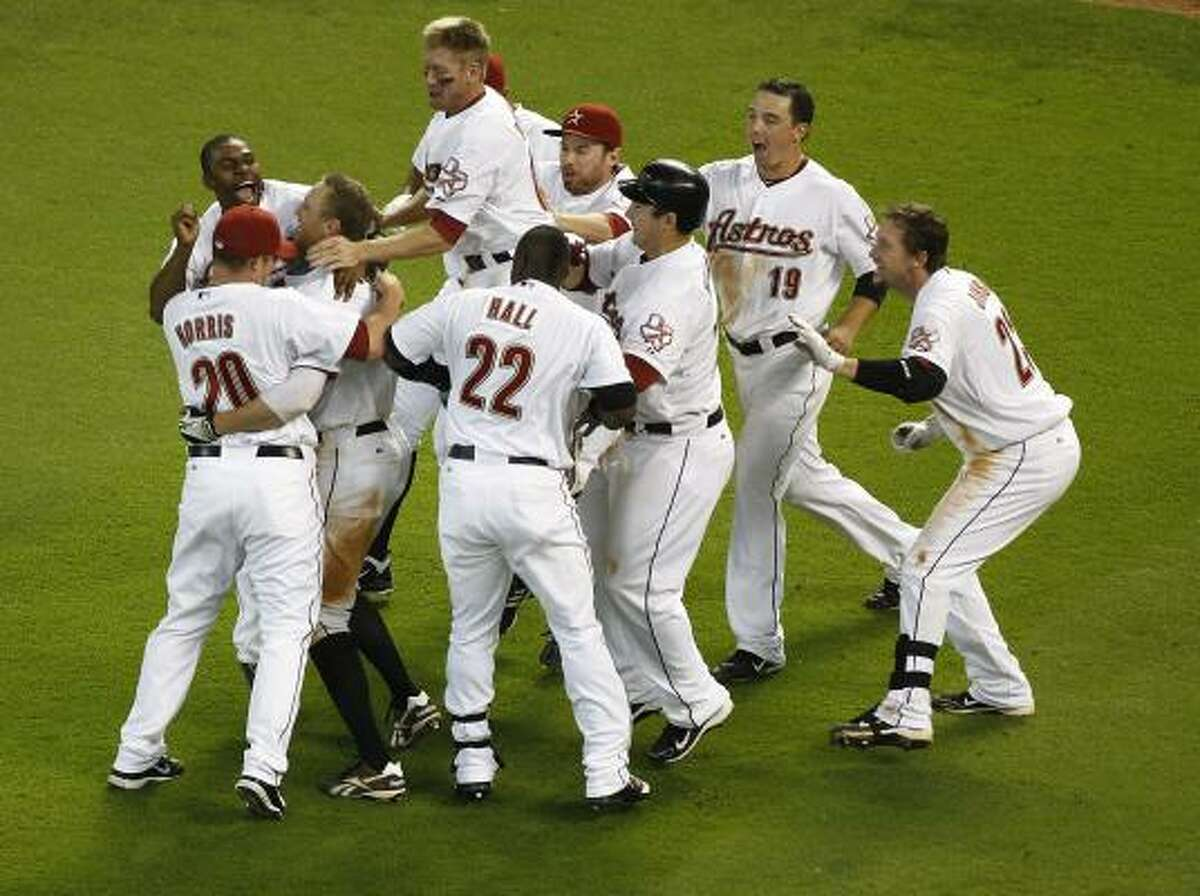 May 11: Astros 4, Reds 3 Astros players run out of the dugout to celebrate with Hunter Pence after his game-winning RBI single.