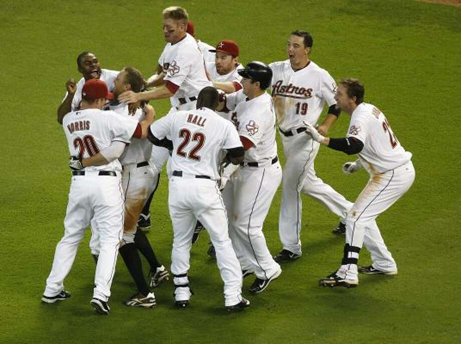 May 11: Astros 4, Reds 3 Astros players run out of the dugout to celebrate with Hunter Pence after his game-winning RBI single. Photo: Nick De La Torre, Chronicle