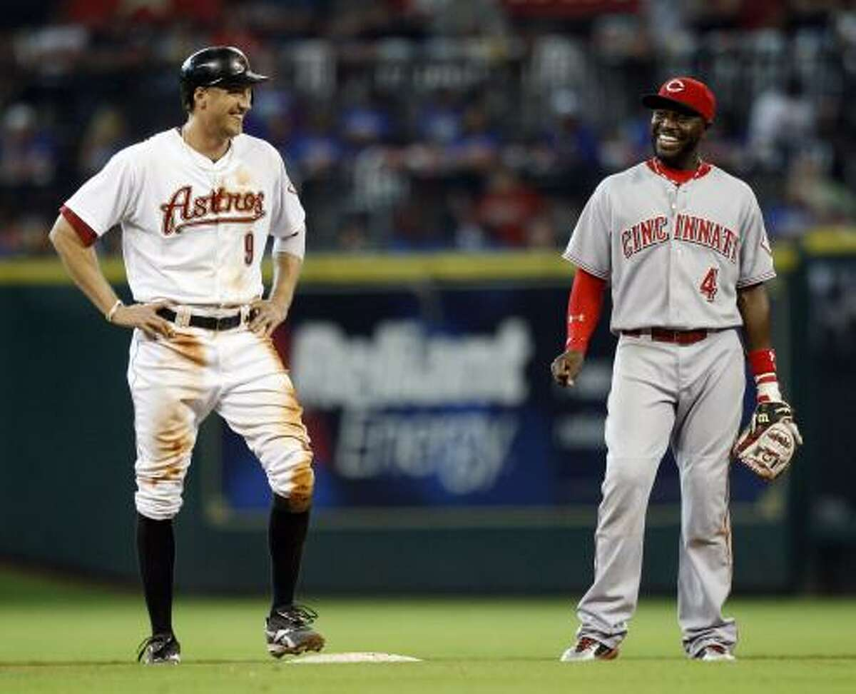 Astros right fielder Hunter Pence and Brandon Phillips #4 of the Cincinnati Reds chat during a break in the play after Pence doubled.