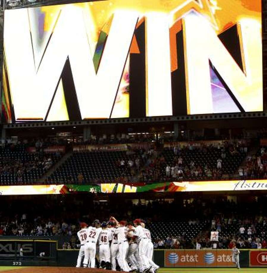 The Houston Astros celebrate a 4-3 win over the Cincinnati Reds. Photo: Bob Levey, Getty