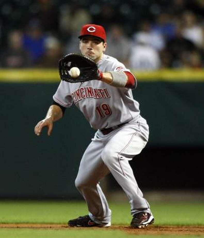 Reds first baseman Joey Votto fields a ground ball. Photo: Bob Levey, Getty