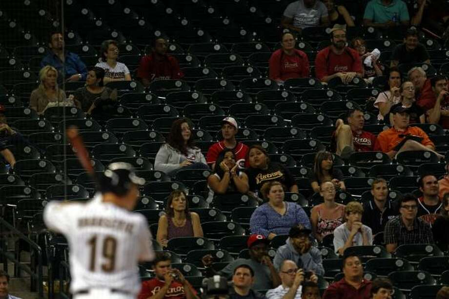 Astros right fielder Brian Bogusevic bats as fans empty the ball park in the ninth inning. Photo: Johnny Hanson, Chronicle