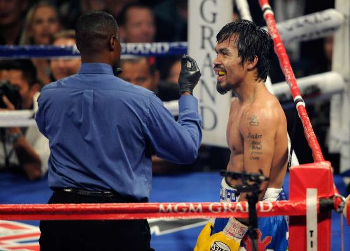 Referee Kenny Bayless counts after Manny Pacquiao is knocked down in the 10th round by Shane Mosley.