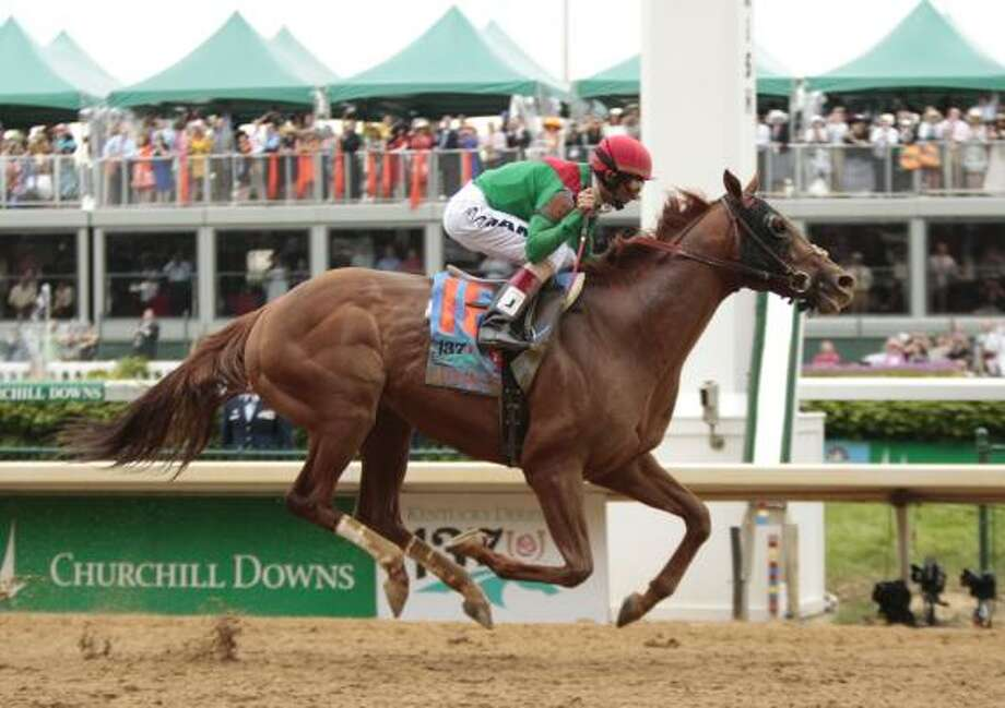 Animal Kingdom, ridden by John R. Velazquez, crosses the finish line first in the 137th Kentucky Derby at Churchill Downs on Saturday in Louisville, Ky. Photo: Pablo Alcala, McClatchy-Tribune News Service