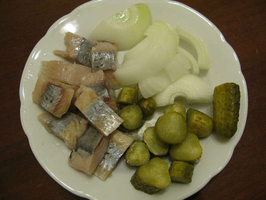 """German: Katerfrühstück, which translates to """"Tomcat's Breakfast."""" Salty pickled herring, onions and pickles replace electrolytes, just like Gatorade. Photo: Roman, Flickr Creative Commons"""