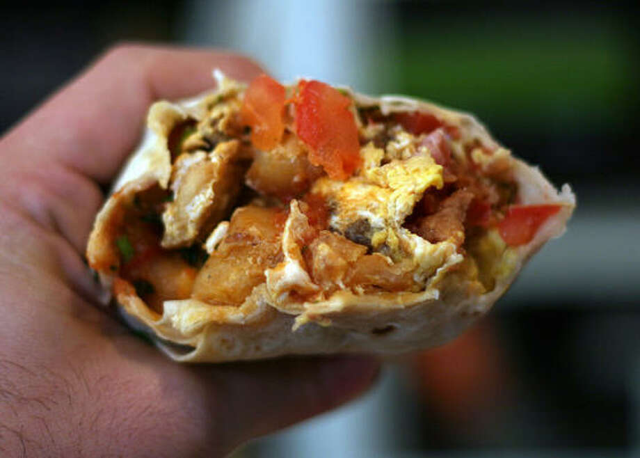 Texas: Breakfast taco. That yummy combo of greasy and spicy always hits the spot. Photo: Marshall Astor, Flickr Creative Commons