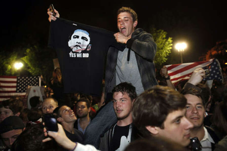 A man holds up a shirt of President Barack Obama as crowds celebrate on Pennsylvania Avenue in front of the White House in Washington after President Barack Obama announced that Osama bin Laden had been killed. Photo: Jacquelyn Martin, ASSOCIATED PRESS