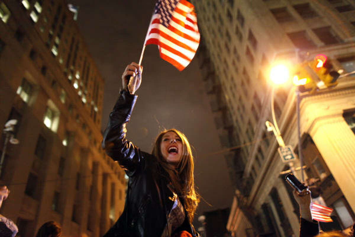 A large, jubilant crowd reacts to the news of Osama Bin Laden's death at the corner of Church and Vesey Streets, adjacent to ground zero, during the early morning hours in New York.