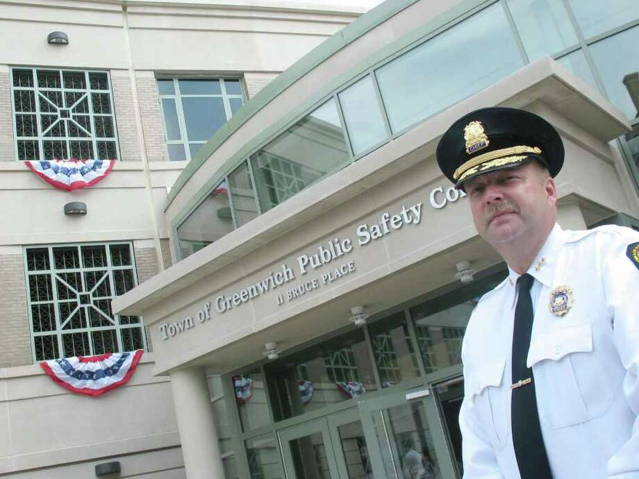 Police Chief David Ridberg stands in front of the new Greenwich police headquarters, in this file photo. Ridberg will step down at the end of October, the town announced Friday, July 29, 2011. Photo: File Photo / Greenwich Time File Photo