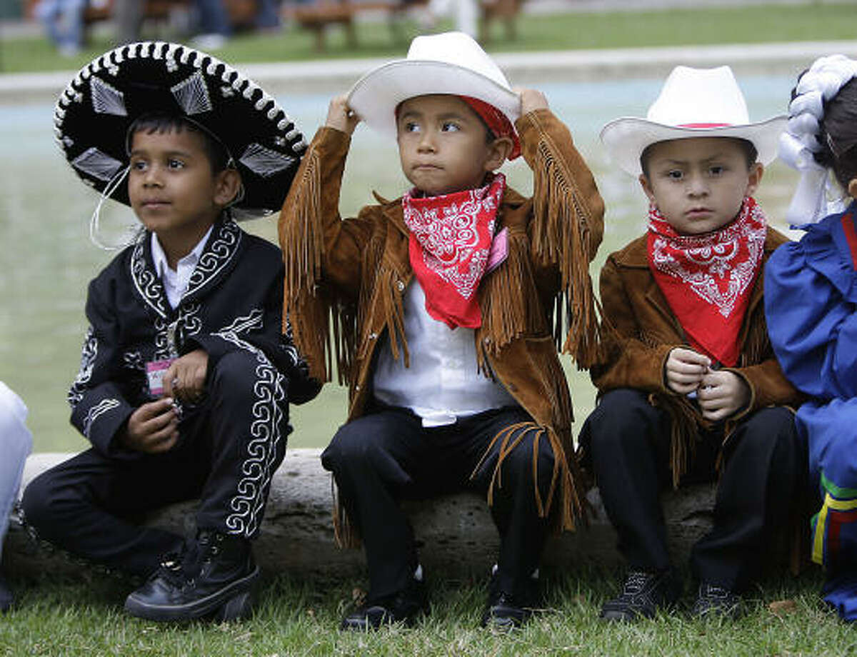 Wilson Gonzalez, Jose Guerra, center, and Andres Martinez, all 5, from Crespo Elementary School dressed to represent Tampico after The Sisters Cities International Children's Parade in front of City Hall as officials kicked off the 2011 Houston International Festival.
