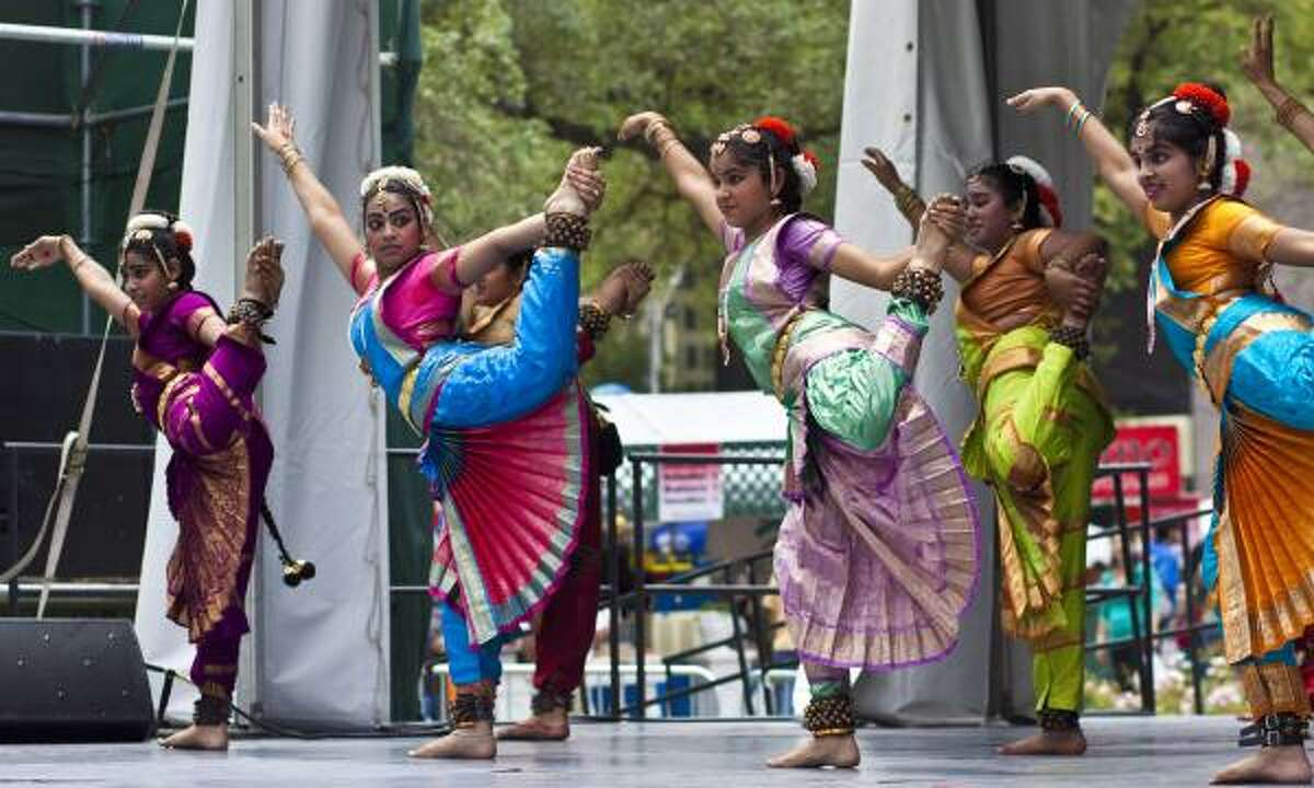 Performers from the Nirthyasri Dance School in Sugar Land entertain the crowd.