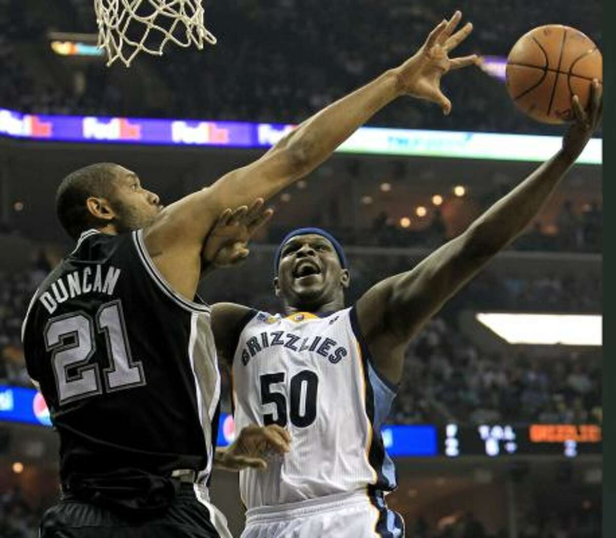 Grizzlies forward Zach Randolph (50) shoots over the reach of Spurs forward Tim Duncan during the first half. Randolph finished with 31 points and 11 rebounds.