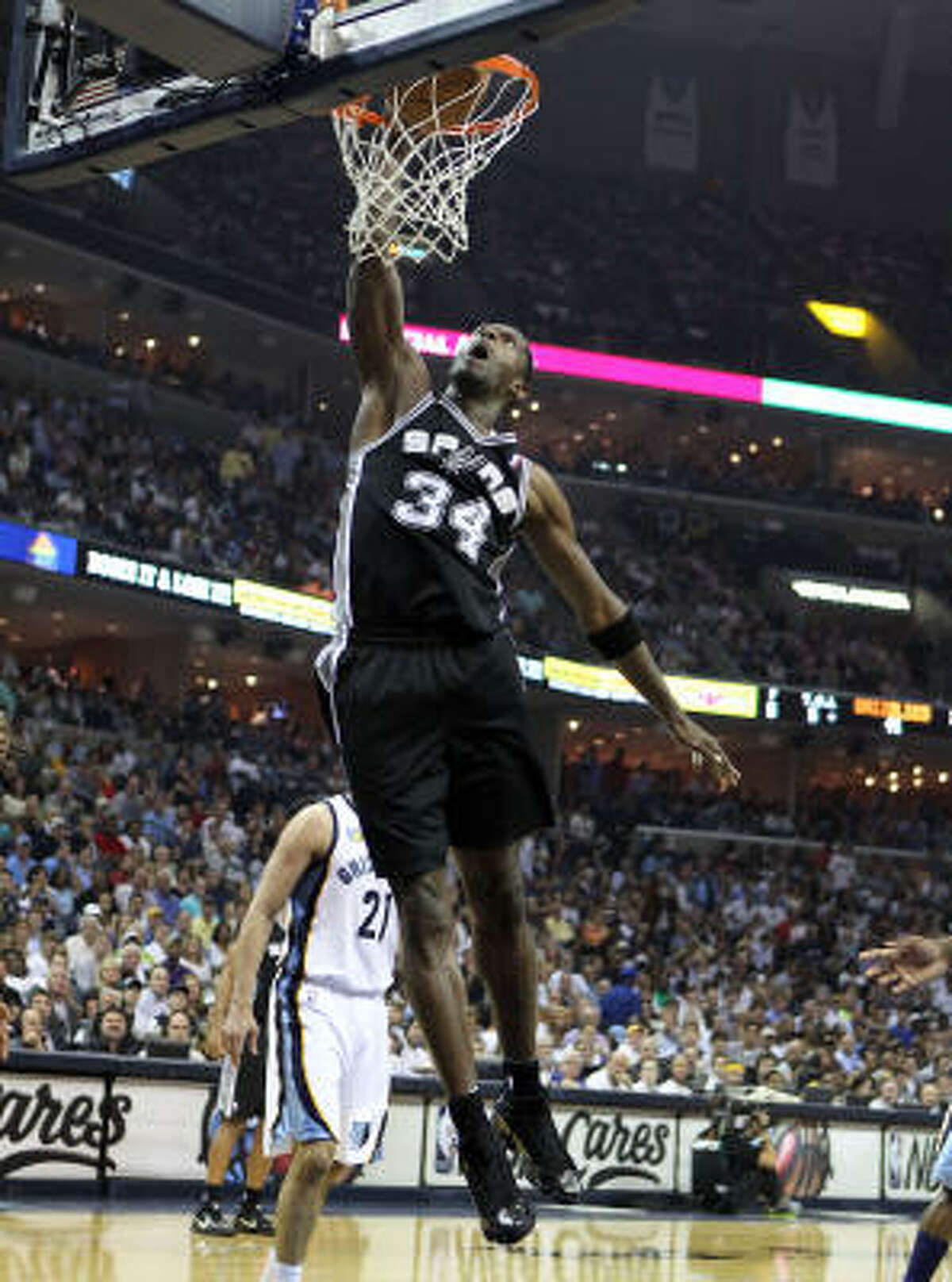San Antonio's Antonio McDyess throws down a dunk.