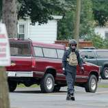 """A helmet clad motorcycle rider is captured during filming for """"The Place Beyond the Pines,"""" Scotia N.Y., Friday morning, July 29, 2011. Actor Ryan Gosling was seen wearing the same outfit during Friday?s shooting. (Erin Colligan / Special to the Times Union)"""