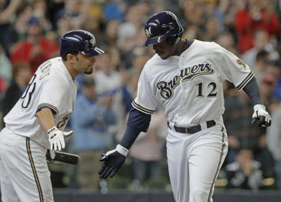 Brewers right fielder Brandon Boggs crosses home plate and high fives catcher Wil Nieves after Boggs hit a home run during the second inning. Photo: Morry Gash, AP