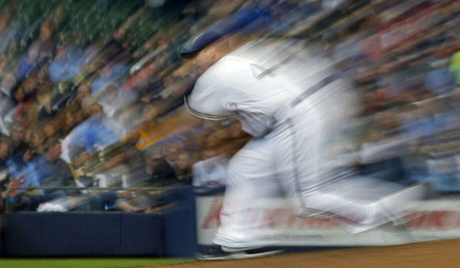 Brewers starting pitcher Randy Wolf, shown in this image made with a slow shutter speed, lowered his ERA to 2.64. Photo: Morry Gash, AP