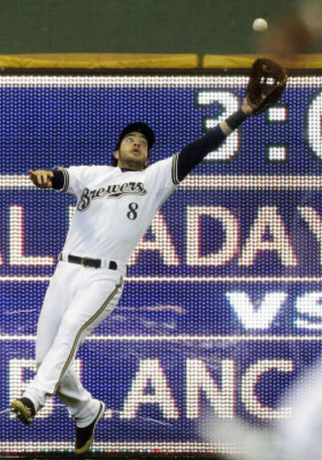 Brewers left fielder Ryan Braun catches a ball hit by Astros right fielder Hunter Pence during the seventh inning. Photo: Morry Gash, AP