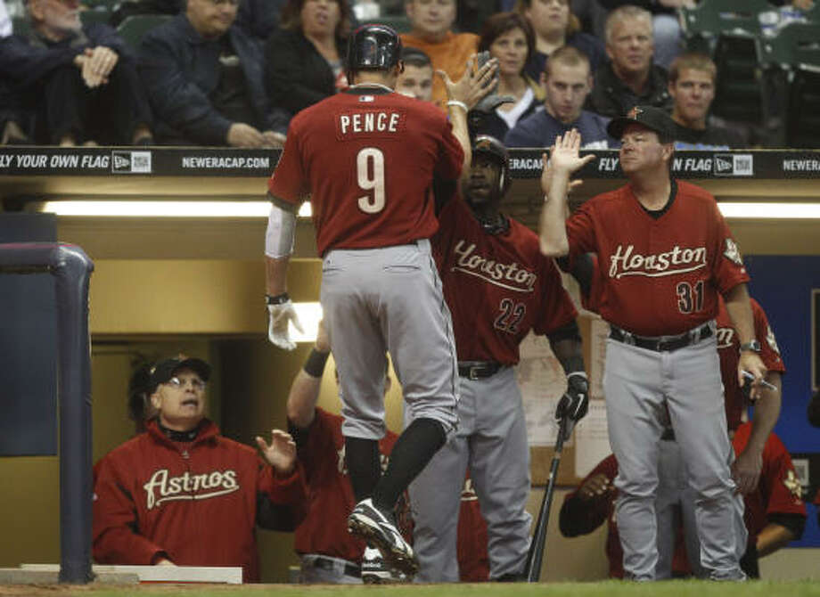April 23: Astros 9, Brewers 6 (10 innings)Hunter Pence (9) is greeted at the dugout after hitting a home run during the third inning of Saturday's game in Milwaukee. Photo: Morry Gash, AP