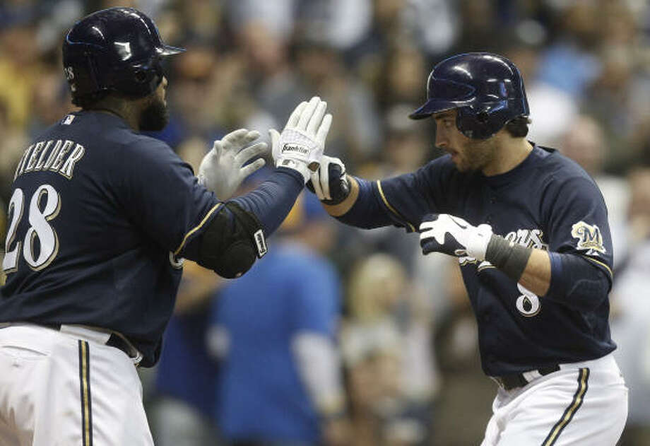 Milwaukee's Ryan Braun (8) celebrates with Prince Fielder after hitting a two-run home run during the seventh inning. Photo: Morry Gash, AP