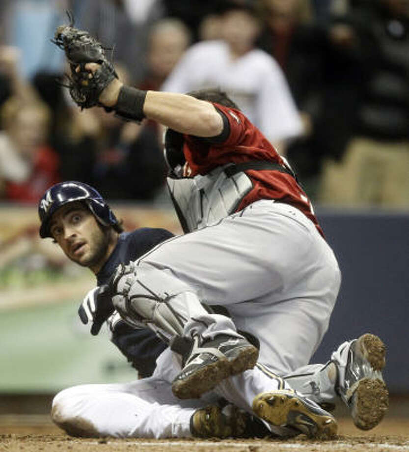 Milwaukee's Ryan Braun slides safely under the tag of Astros catcher Humberto Quintero during the ninth inning. Braun scored from second on a double by Prince Fielder. Photo: Morry Gash, AP