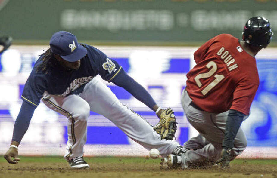 April 22: Brewers 14, Astros 7Milwaukee Brewers second baseman Rickie Weeks cannot handle the throw as Astros' Michael Bourn steals second during the third inning. Photo: Morry Gash, AP