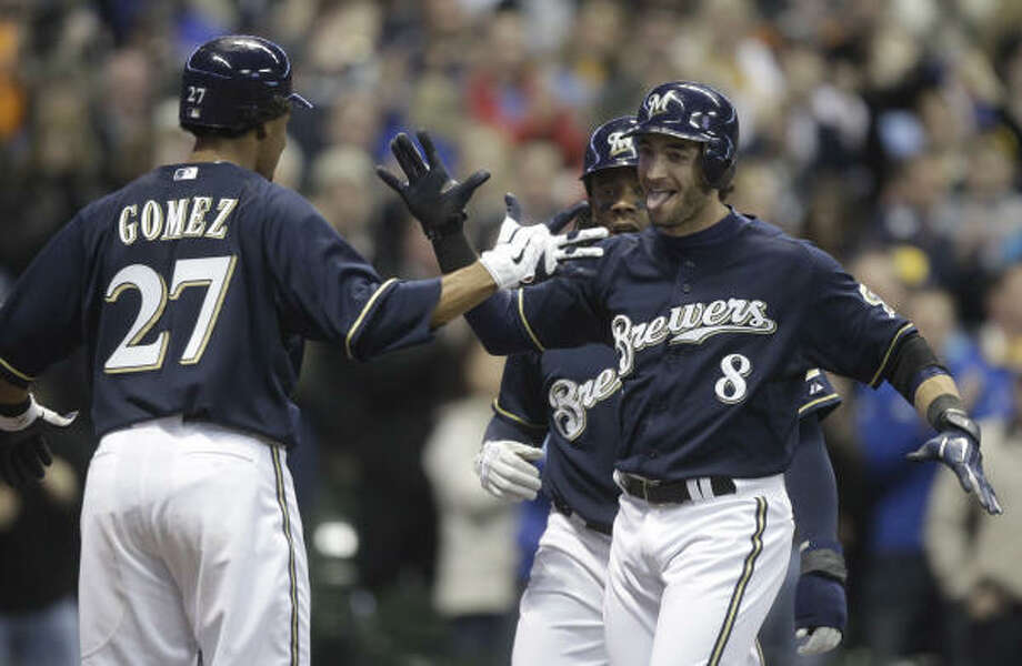 Milwaukee Brewers' Ryan Braun is congratulated by teammates Carlos Gomez  and Rickie Weeks  after hitting a three-run home run during the third inning. Photo: Morry Gash, AP