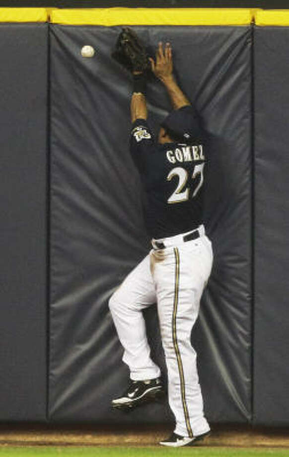 Milwaukee Brewers centerfielder Carlos Gomez cannot come up with a triple off the bat of Astros' Bill Hall during the third inning. Photo: Morry Gash, AP