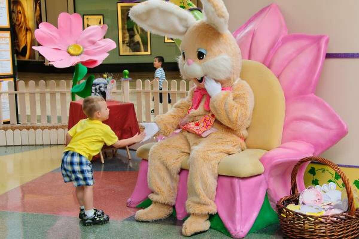Smart boy Wyatt Goodwin, 3, of Deer Park keeps a safe distance from the Easter Bunny at Baybrook Mall.
