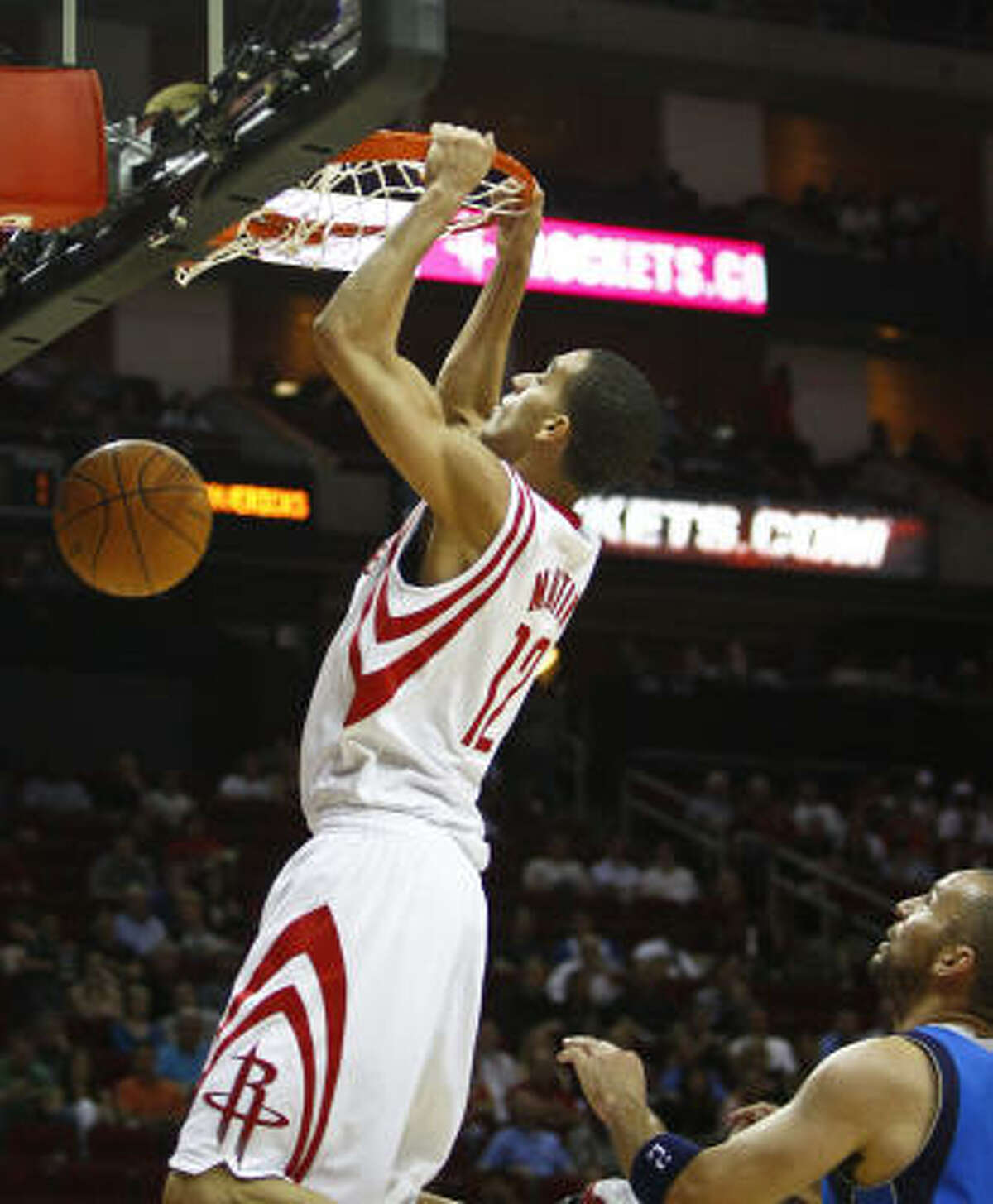Rockets shooting guard Kevin Martin (12) dunks the ball during the first half.