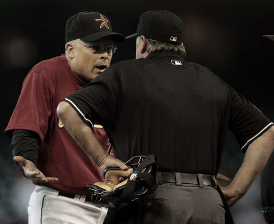 Astros manager Brad Mills, left, argues with home plate umpire Jim Joyce after he ejected pitcher Aneury Rodriguez in the ninth inning. Photo: Bob Levey, AP