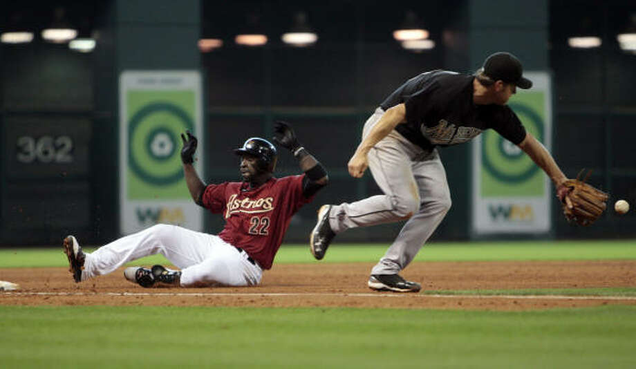 Astros' Bill Hall slides safely into third base after hitting a triple. Photo: Bob Levey, AP