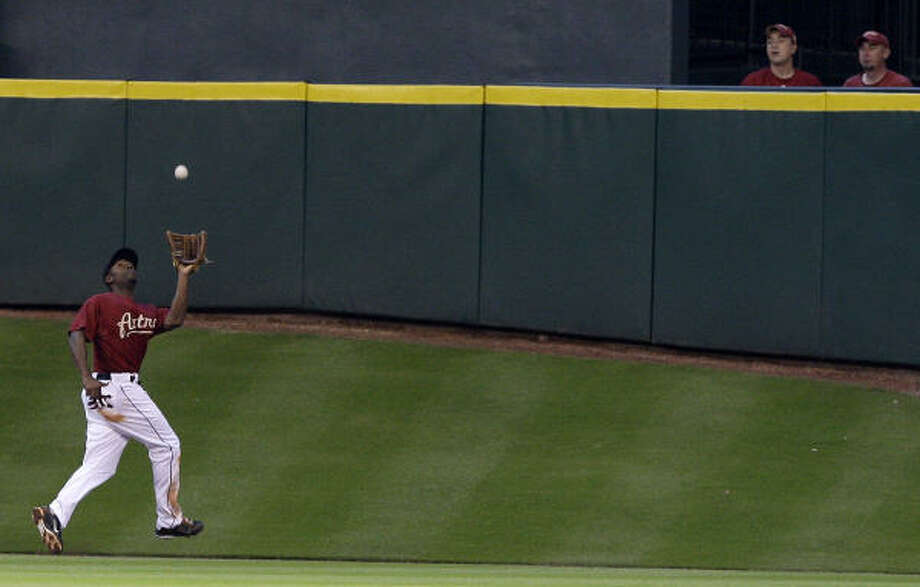 Astros center fielder Michael Bourn makes an over the shoulder catch in the second inning. Photo: Thomas B. Shea, Getty Images