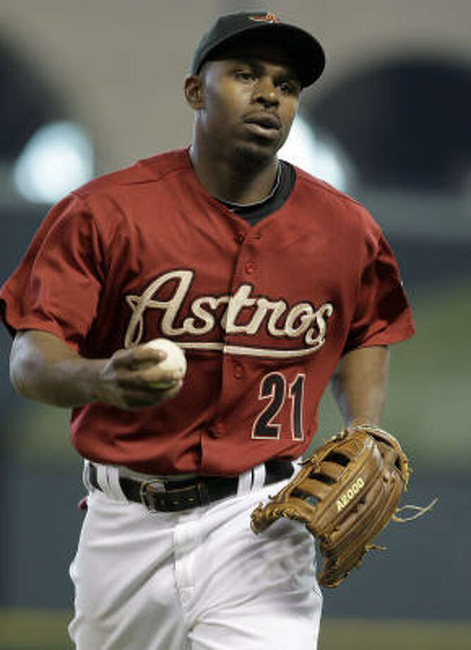 Astros center fielder Michael Bourn runs the ball in after his second-inning catch. Photo: Thomas B. Shea, Getty Images