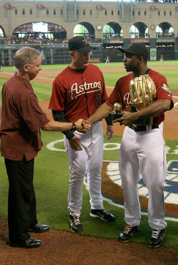Astros general Manager Ed Wade and manager Brad Mills congratulate center fielder Michael Bourn during the ceremony for his  2010 Golden Glove. Photo: Thomas B. Shea, Getty Images