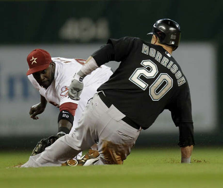 April 9: Marlins 7, Astros 5Astros second baseman Bill Hall, left, tries to apply a tag on Florida's Logan Morrison during the third inning. Morrison reached on a double. Photo: Karen Warren, Chronicle