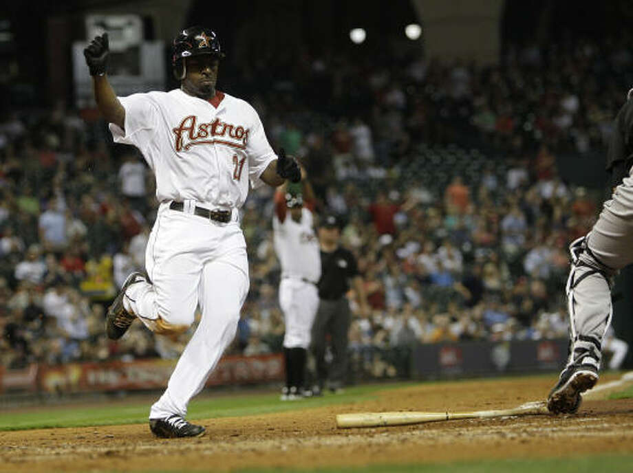 Michael Bourn comes in for the score on a Hunter Pence single during the fifth inning. Photo: Karen Warren, Chronicle