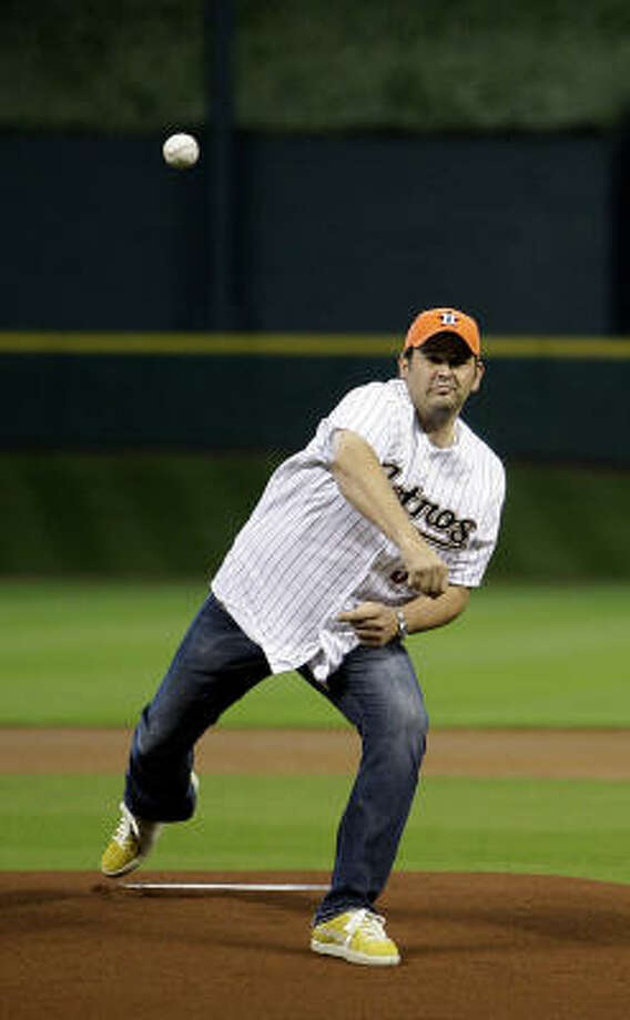 Brian Caswell throws out the first pitch before the start of Saturday's game. Photo: Karen Warren, Chronicle