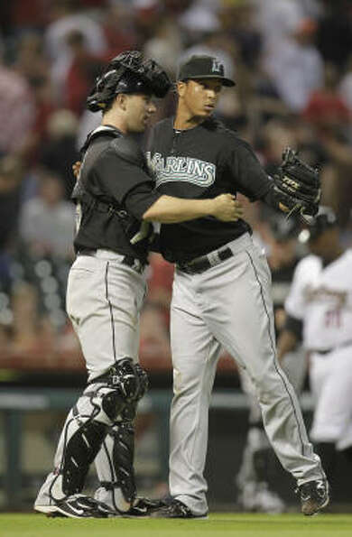 Marlins catcher Brett Hayes hugs closer Leo Nunez after closing out Friday's 4-3 win over the Astros