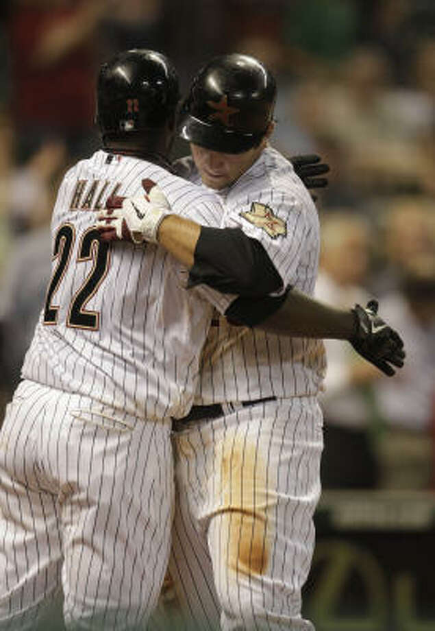 Brett Wallace hugs Bill Hall after hitting a solo home run during the ninth inning. Photo: Karen Warren, Chronicle