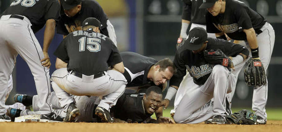Marlins shortstop Hanley Ramirez screams after he was injured crashing into Bill Hall while trying to turn a double play in the seventh inning. Photo: Karen Warren, Chronicle