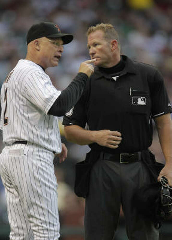 Astros manager Brad Mills argues a call with home plate umpire Jim Wolf during the fourth inning. Photo: Karen Warren, Chronicle
