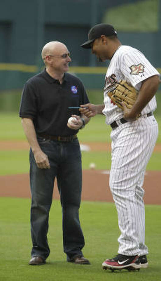 Astronaut Scott Kelly chats with Carlos Lee after he threw out the first pitch. Photo: Karen Warren, Chronicle