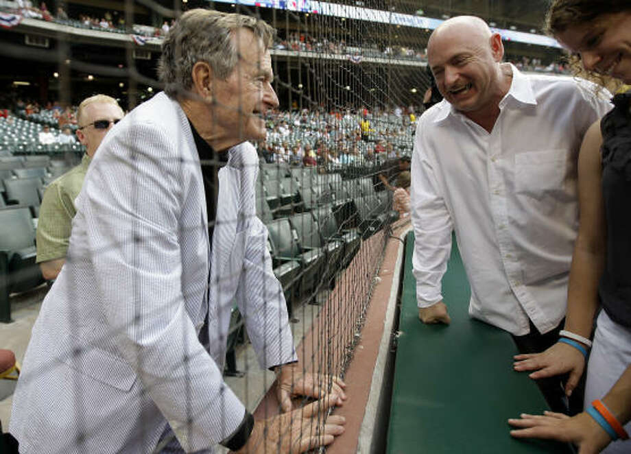 Astronaut Mark Kelly chats with former President George H.W. Bush before the start of the Astros home opener against the Marlins at Minute Maid Park, Friday, April 8, 2011, in Houston. Photo: Karen Warren, Chronicle