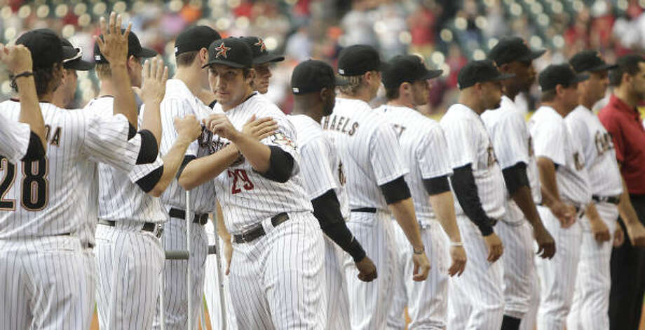 Astros first baseman Brett Wallace hugs teammate Jason Castro during player introductions. Photo: Karen Warren, Chronicle