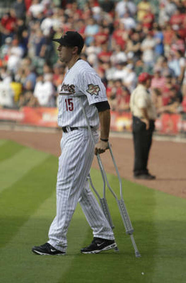 Injured catcher Jason Castro walks out onto the field on crutches during player introductions. Photo: Karen Warren, Chronicle